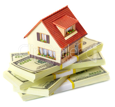house on packs of banknotes