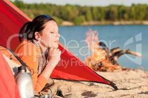 Camping happy woman relax in tent by campfire