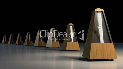 A line of ticking metronomes.