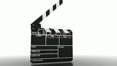 Close view of different parts of a clapperboard which is closing at the end.
