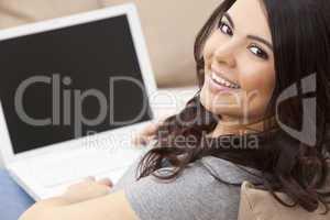 Happy Hispanic Woman Using Laptop Computer