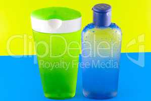 cosmetic containers on a colorful background