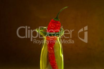 chili pepper in a glass bottle