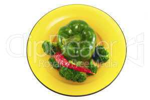pepper and broccoli on a plate isolated on white