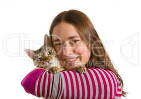 Bengal kitten on arm of young girl facing camera