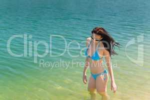 Summer beach woman in bikini swim water