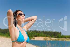 Summer beach woman in blue bikini bra