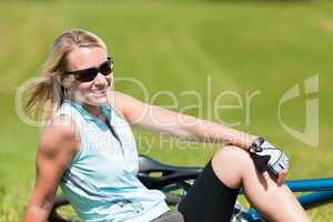 Sport mountain biking girl relax in meadows