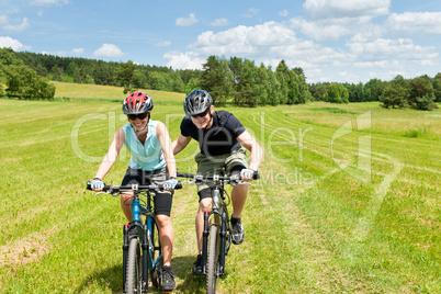 Sport mountain biking - man pushing young girl