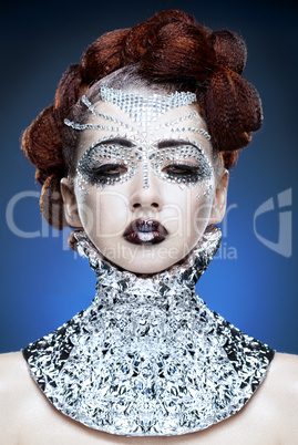 beauty woman makeup with crystals on face