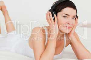 Young brunette listening to music