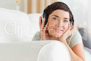 Close up of a short-haired brunette listening to music
