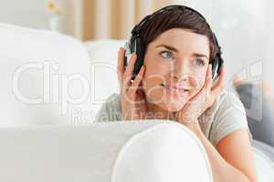 Close up of a short-haired woman listening to music