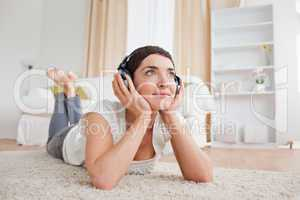 Dreaming woman listening to music