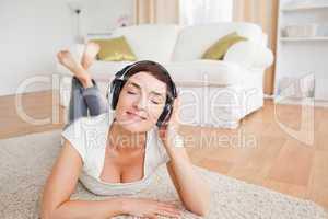 Smiling brunette listening to music