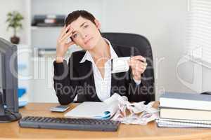 Serious accountant checking receipts