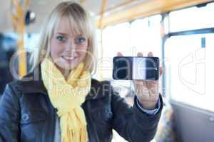 woman with a smartphone inside a bus