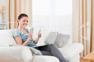 Attractive woman making an online payment with her credit card w