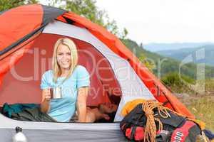 Camping young woman drink mug sunset tent