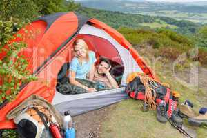Camping young couple sunset tent climbing gear