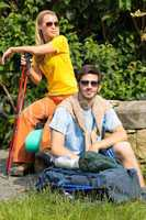 Hiking young couple backpack relax sunny day