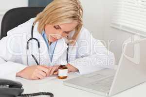 Doctor writing something down