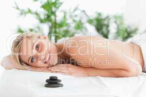 Good looking blonde woman lying on a lounger