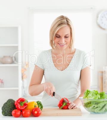 Cute woman cutting vegetables