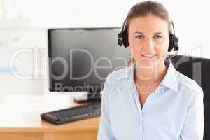Secretary with a headset posing