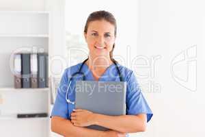 Beautiful nurse holding a folder