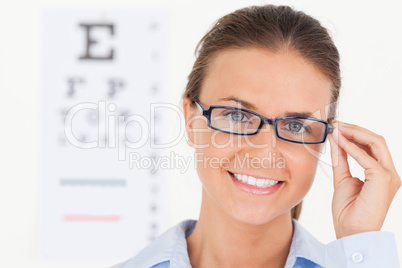 Close up of a good looking brunette eye specialist wearing glass