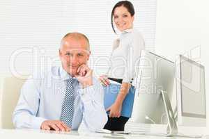 Professional senior businessman woman assistant