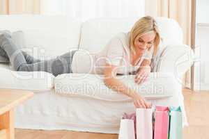 Woman looking in her shopping bags