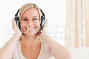 Close up of a lovely woman enjoying some music