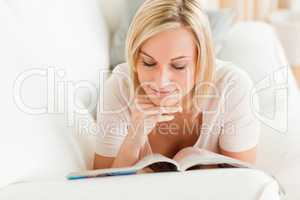 Charming woman  reading a magazine