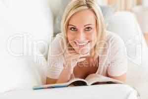 Charming woman with a magazine