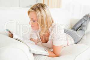 Blonde woman reading a magazine