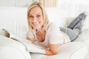 Blonde woman with a magazine