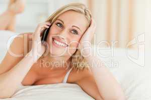 Close up of a smiling woman answering the phone