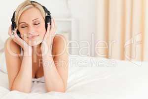 Delighted woman wearing headphones