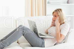 Blonde woman having trouble her laptop
