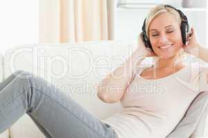 Serene woman listening to music