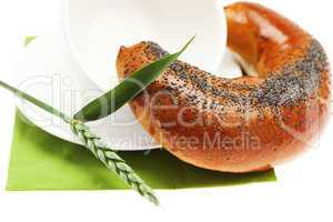 loaf with poppy seeds cup  and the spike isolated on white