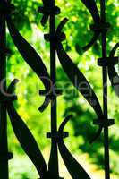 forged grating against the background of green