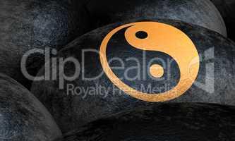 Schwarze Steine mit Yin und Yang Symbol