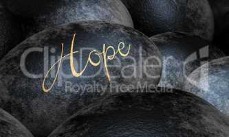 Schwarze Steine mit Text - Hope