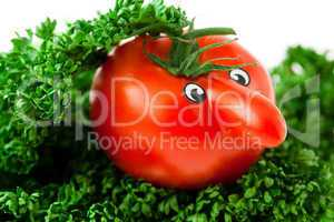 tomato with eyes lying on a plate with greens