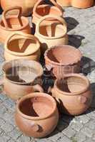 Clay pots on pavement