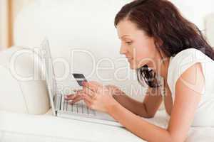 Dark-haired woman doing some online shopping