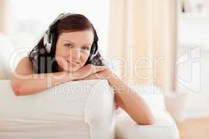 Dark-haired young woman listening to music